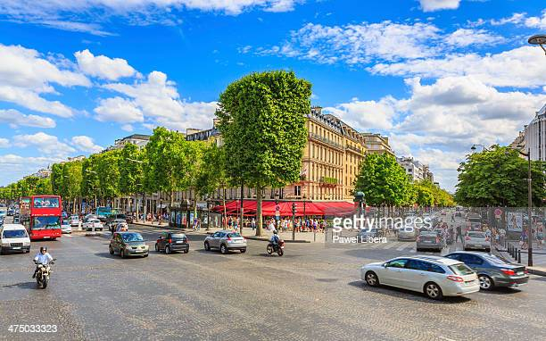 avenue champs elysees in paris. - champs elysees quarter stock pictures, royalty-free photos & images