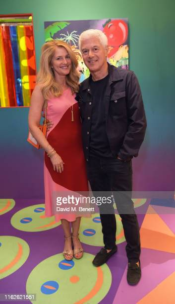 Avery Agnelli and John Frieda attend the 'Hysterical' private view hosted by Gary Card at Phillips Berkeley Square on July 17 2019 in London England