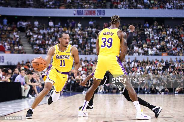 Avery Bradley and Dwight Howard of the Los Angeles Lakers in action during the match against the Brooklyn Nets during a preseason game as part of...
