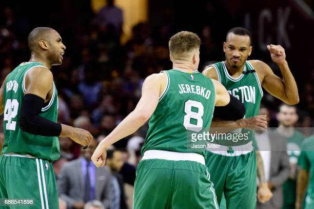 Avery Bradley celebrates with Jonas Jerebko of the Boston Celtics after their 111 to 108 win over the Cleveland Cavaliers during Game Three of the...