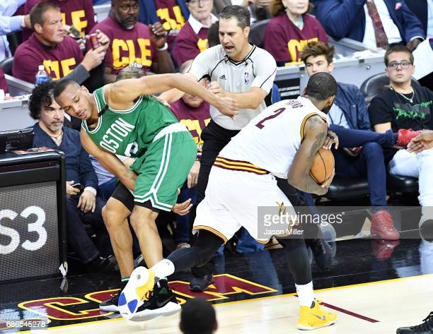Avery Bradley of the Boston Celtics and Kyrie Irving of the Cleveland Cavaliers collide in the second half during Game Three of the 2017 NBA Eastern...