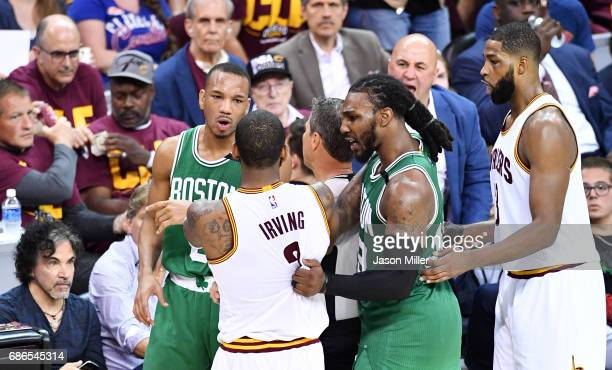 Avery Bradley of the Boston Celtics and Kyrie Irving of the Cleveland Cavaliers exchange words in the second half during Game Three of the 2017 NBA...