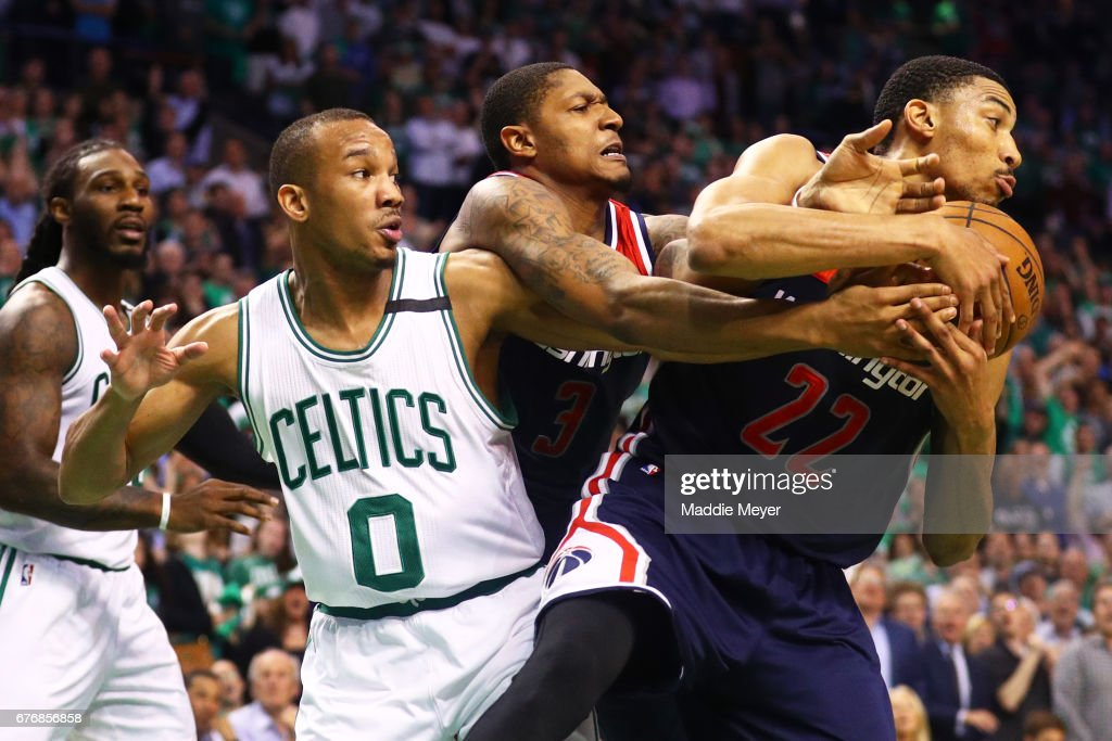 Avery Bradley #0 of the Boston Celtics, Bradley Beal #3 and Otto Porter Jr. #22 of the Washington Wizards battle for a rebound during the fourth quarter of Game Two of the Eastern Conference Semifinals at TD Garden on May 2, 2017 in Boston, Massachusetts. The Celtics defeat the Wizards 129-119.