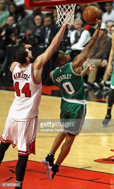 Avery Bradley of the Boston Celtics drives past Nikola Mirotic of the Chicago Bulls on his way to a teamhigh 23 points during Game Six of the Eastern...