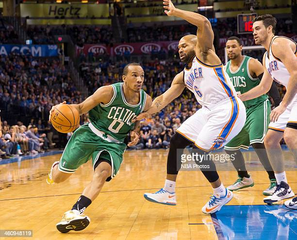 Avery Bradley of the Boston Celtics drives to the basket against Derek Fisher of the Oklahoma City Thunder at the Chesapeake Arena on January 5 2014...