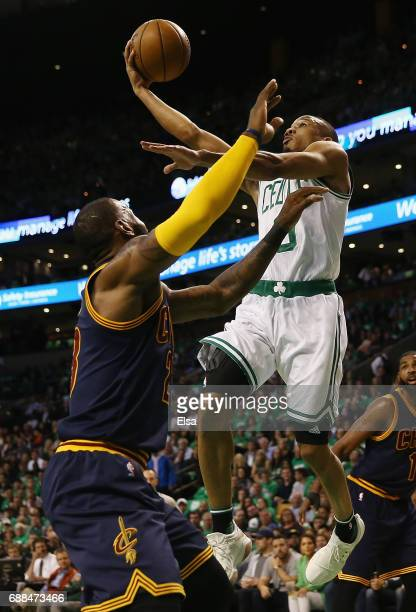 Avery Bradley of the Boston Celtics drives to the basket against LeBron James of the Cleveland Cavaliers in the first half during Game Five of the...