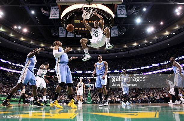 Avery Bradley of the Boston Celtics dunks the ball against the Denver Nuggets in the second quarter during the game at TD Garden on December 6 2013...
