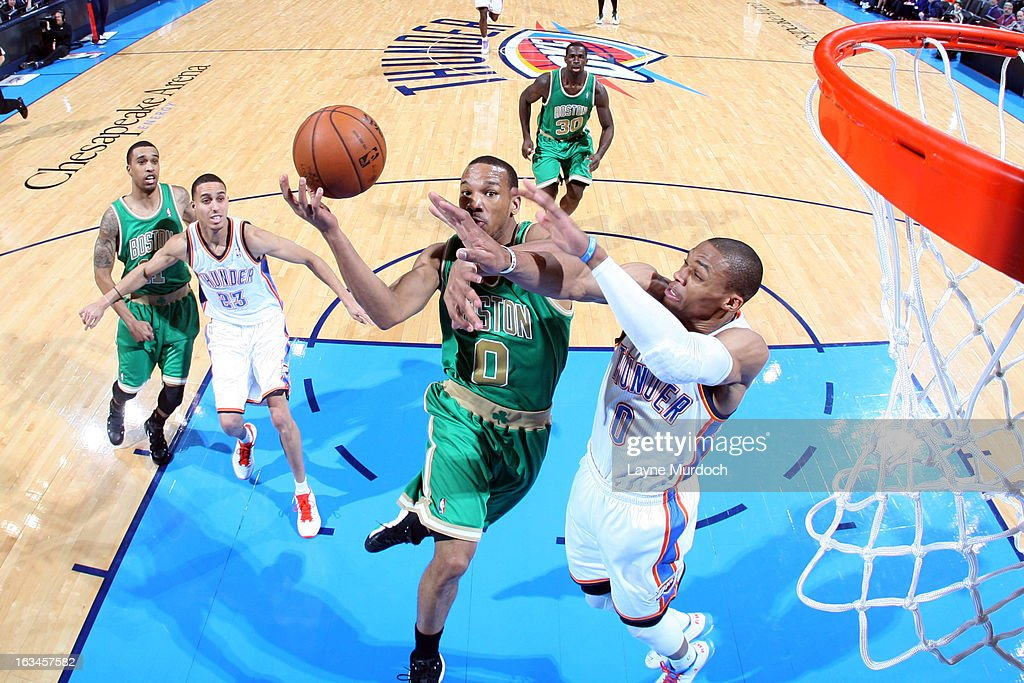 Avery Bradley #0 of the Boston Celtics goes to the basket against Russell Westbrook #0 of the Oklahoma City Thunder during the game between the Oklahoma City Thunder and the Boston Celtics on March 10, 2013 at the Chesapeake Energy Arena in Oklahoma City, Oklahoma.