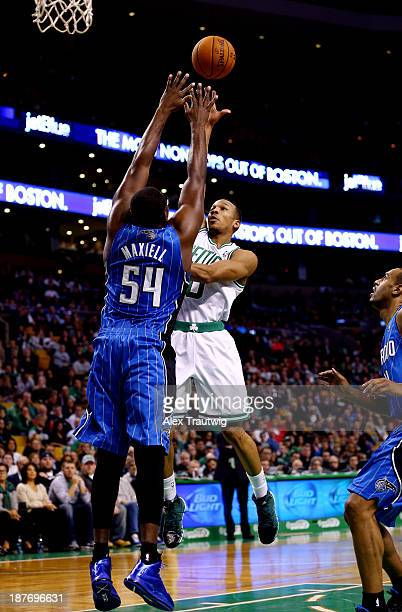 Avery Bradley of the Boston Celtics goes to the basket as Jason Maxiell of the Orlando Magic defends during a game at the TD Garden on November 11...