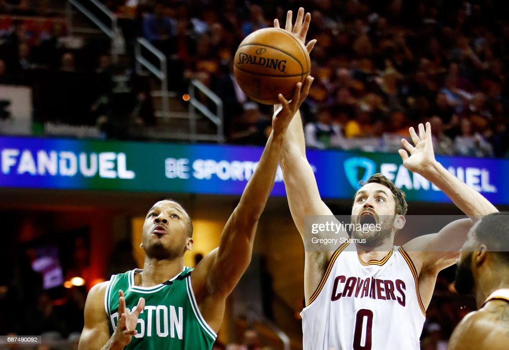 Avery Bradley #0 of the Boston Celtics goes up against Kevin Love #0 of the Cleveland Cavaliers in the first half during Game Four of the 2017 NBA Eastern Conference Finals at Quicken Loans Arena on May 23, 2017 in Cleveland, Ohio.