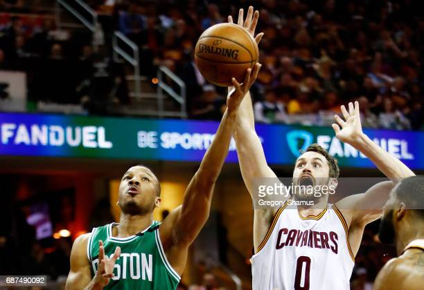 Avery Bradley of the Boston Celtics goes up against Kevin Love of the Cleveland Cavaliers in the first half during Game Four of the 2017 NBA Eastern...
