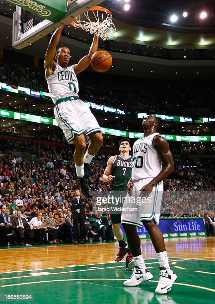 Avery Bradley of the Boston Celtics goes up for a dunk in the first half against the Milwaukee Bucks during the home opener at TD Garden on November...