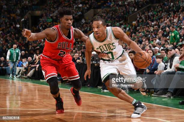 Avery Bradley of the Boston Celtics handles the ball against Jimmy Butler of the Chicago Bulls during the game on March 12 2017 at the TD Garden in...