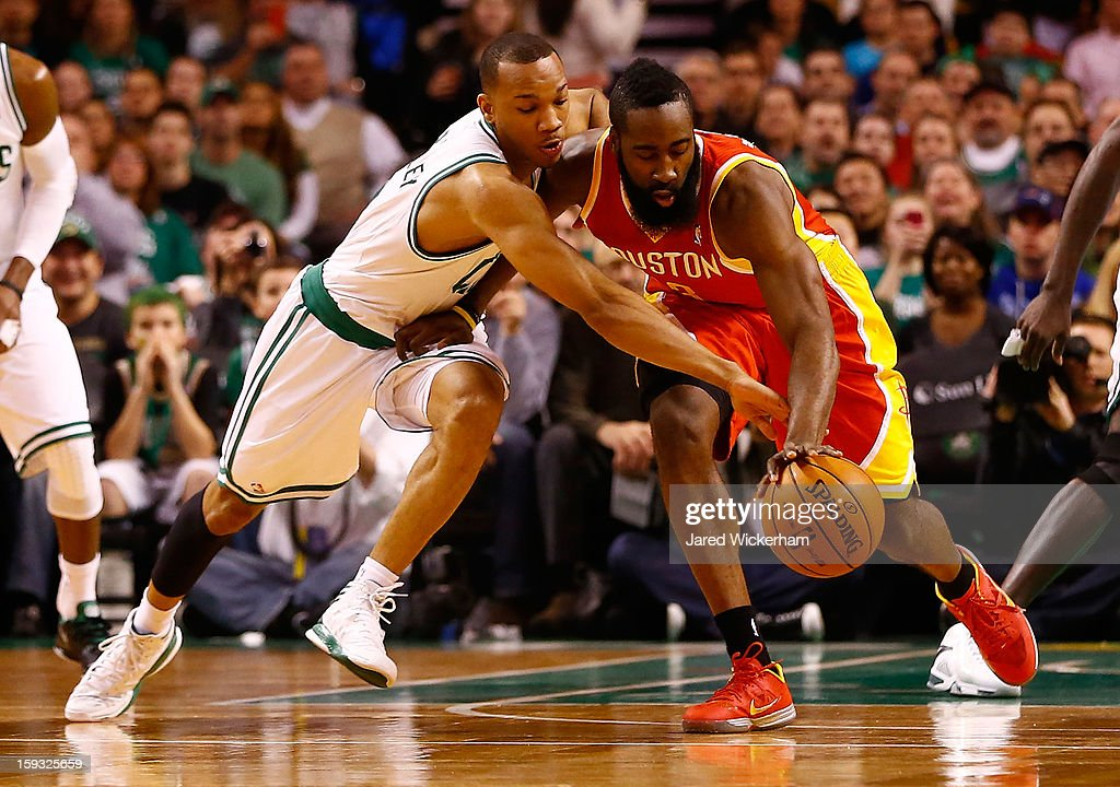 Avery Bradley #0 of the Boston Celtics knocks the ball out of the hands of James Harden #13 of the Houston Rockets during the game on January 11, 2013 at TD Garden in Boston, Massachusetts.