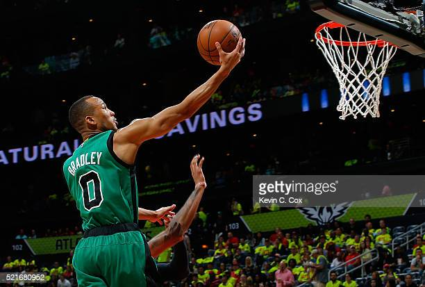 Avery Bradley of the Boston Celtics lays in a basket against Kent Bazemore of the Atlanta Hawks in Game One of the Eastern Conference Quarterfinals...