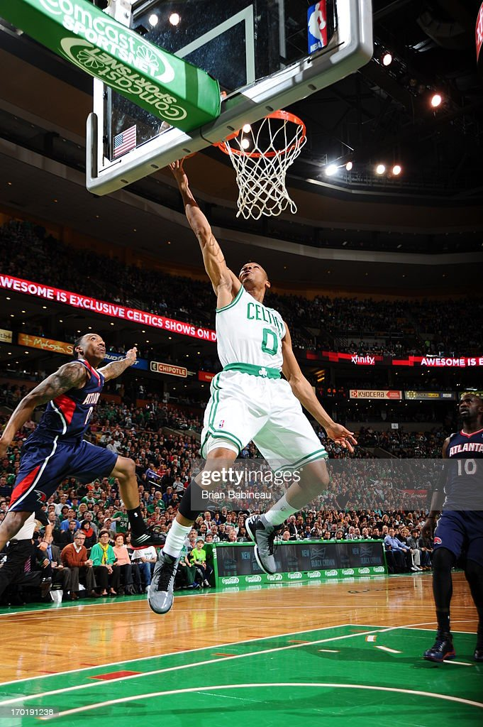 Avery Bradley #0 of the Boston Celtics shoots a layup against Jeff Teague #0 of the Atlanta Hawks on March 29, 2013 at the TD Garden in Boston, Massachusetts.