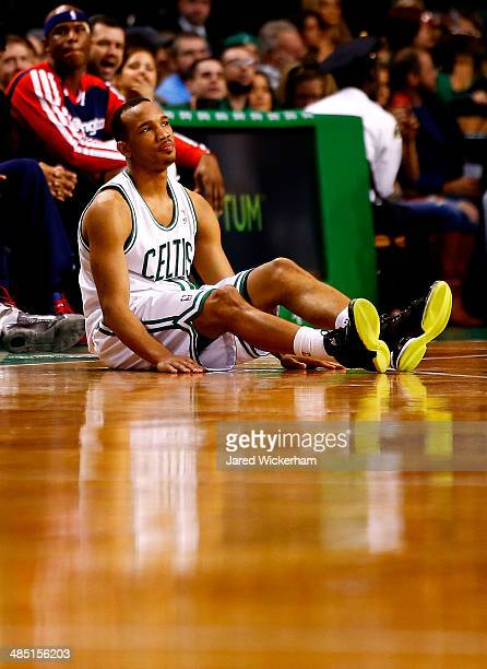 Avery Bradley of the Boston Celtics sits on the court after losing posession of the ball against the Washington Wizards in the second half during the...