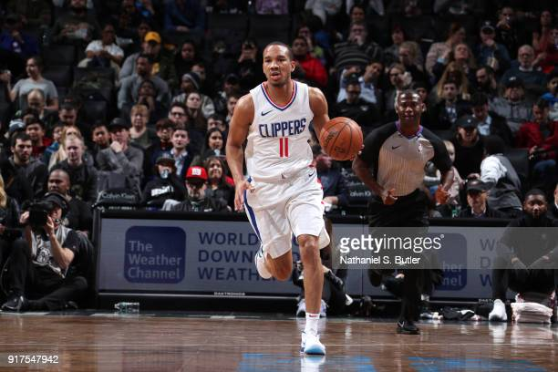 Avery Bradley of the LA Clippers brings the ball up court against the Brooklyn Nets on February 12 2018 at Barclays Center in Brooklyn New York NOTE...