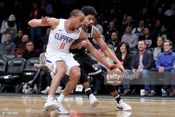 Avery Bradley of the LA Clippers defends against Spencer Dinwiddie of the Brooklyn Nets in the first quarter during their game at Barclays Center on...