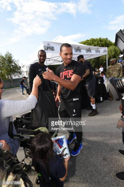 Avery Bradley of the LA Clippers distributes food and personal care items on October 13 2018 at the Salvation Army Siemon Family Youth Community...