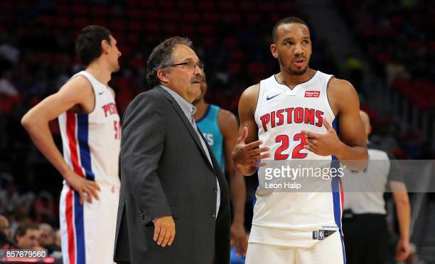 Avery Bradley of the Detroit Pistons and head coach Stan Van Gundy talk during a time out in the third quarter of the preseason game against the...