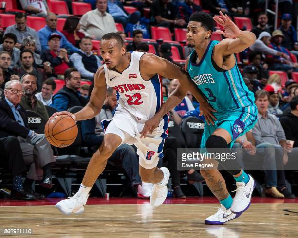 Avery Bradley of the Detroit Pistons drives the basket as Jeremy Lamb of the Charlotte Hornets defends during the Inaugural NBA game at the new...