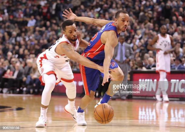 Avery Bradley of the Detroit Pistons is fouled by Norman Powell of Toronto Raptors at Air Canada Centre on January 17 2018 in Toronto Canada NOTE TO...