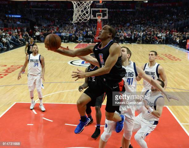 Avery Bradley of the Los Angeles Clippers scores a basket against Dirk Nowitzki of the Dallas Mavericks during the second half at Staples Center on...