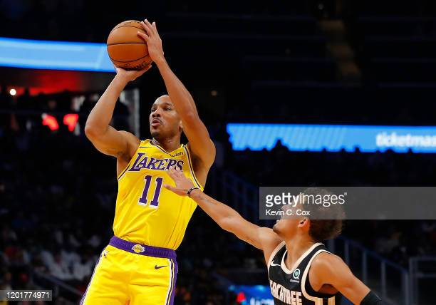 Avery Bradley of the Los Angeles Lakers against Trae Young of the Atlanta Hawks at State Farm Arena on December 15, 2019 in Atlanta, Georgia. NOTE TO...