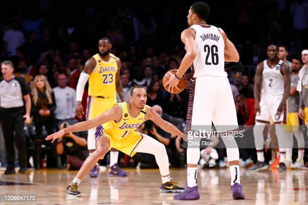 Avery Bradley of the Los Angeles Lakers defends on Spencer Dinwiddie of the Brooklyn Nets during a game at the Staples Center on March 10, 2020 in...