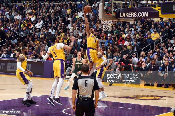 Avery Bradley of the Los Angeles Lakers reaches for the ball during the game against the Milwaukee Bucks on March 6 2020 at STAPLES Center in Los...