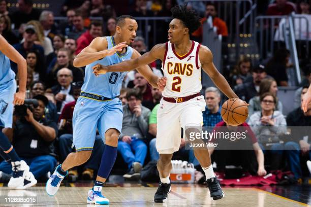 Avery Bradley of the Memphis Grizzlies guards Collin Sexton of the Cleveland Cavaliers during the first half at Quicken Loans Arena on February 23...