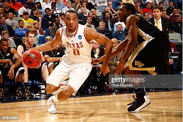 Avery Bradley of the Texas Longhorns drives the ball around Ishmael Smith of the Wake Forest Demon Deacons during the first round of the 2010 NCAA...