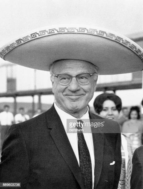 Avery Brundage president of the International Olympic Committee sports a big grin and equally big Mexican sombrero at an Olympic soccer match