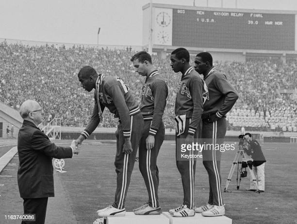 Avery Brundage, President of the International Olympic Committee presents the winning gold medals to Otis Paul Drayton, Gerald Ashworth, Richard...