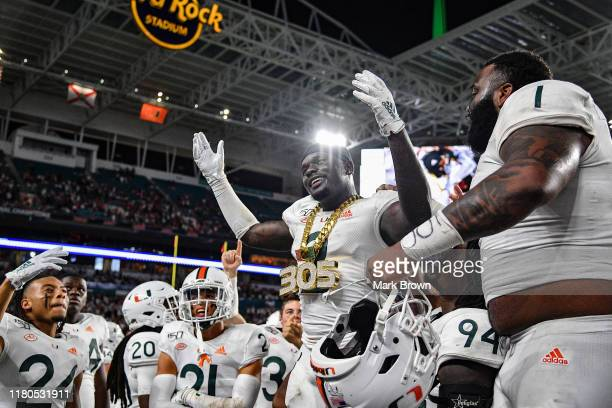 Avery Huff of the Miami Hurricanes celebrates with the Turnover 305 Chain against the Virginia Cavaliers in the second half at Hard Rock Stadium on...