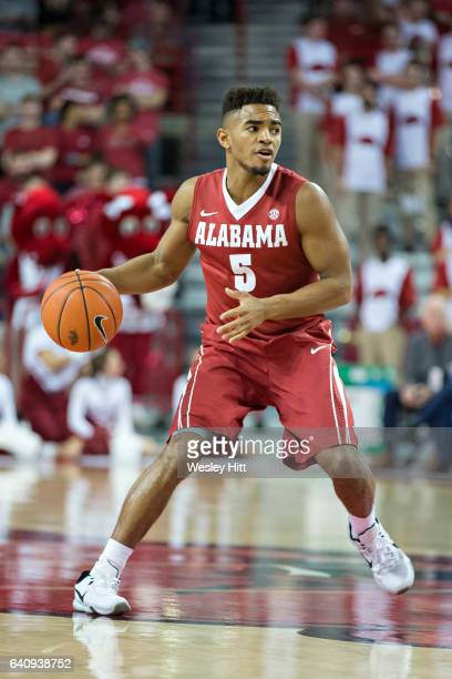 Avery Johnson Jr #5 of the Alabama Crimson Tide dribbles down the court during a game against the Arkansas Razorbacks at Bud Walton Arena on February...