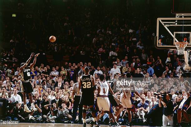 Avery Johnson of the San Antonio Spurs shoots a jump shot against the New York Knicks during Game Four of the 1999 NBA Finals at Madison Square...