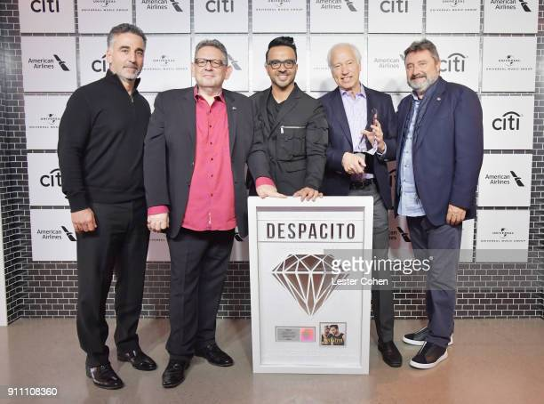 Avery Lipman Chairman and CEO UMG Sir Lucian Grainge musician Luis Fonsi CEO of the Recording Industry Association of America Cary Sherman and Jesus...