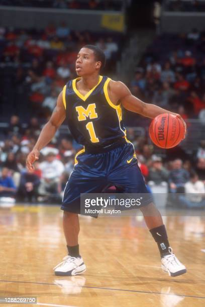 Avery Queen of the Michigan Wolverines dribbles the ball during the BBT Classic college basketball game against the St John's Redman at MCI Center on...