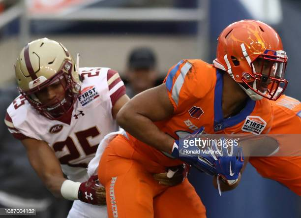 Avery Williams of the Boise State Broncos runs the ball against Mehdi El Attrach of the Boston College Eagles during the SERVPRO First Responder Bowl...