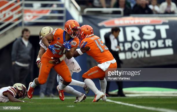 Avery Williams of the Boise State Broncos runs the ball against the Boston College Eagles during the SERVPRO First Responder Bowl at Cotton Bowl on...