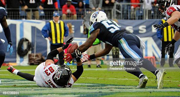 Avery Williamson of the Tennessee Titans makes an interception of a pass intended for Jacob Tamme of the Atlanta Falcons in the end zone during the...