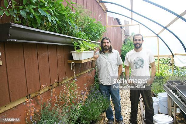 David Homa and Eli Cayer stand in the permaculture garden behind the Urban Farm Fermentory in Portland staff photo
