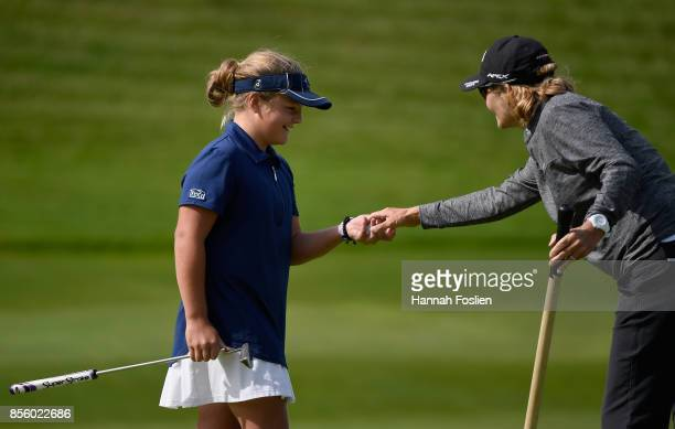 Avery Zweig collects her golf ball after participating in the putting contest for the girls 1011 category at the regional round of the Drive Chip and...