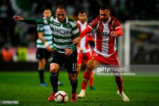 Aves' Argentine midfielder Luis Farina vies with Sporting's Brazilian midfielder Bruno Cesar during the Portuguese League football match Sporting CP...