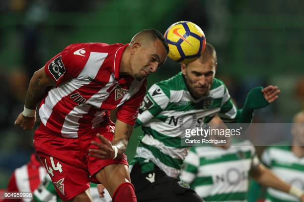 Aves defender Diego Galob from Brazil vies with Sporting CP forward Bas Dost from Holland for the ball possession during the Portuguese Primeira Liga...