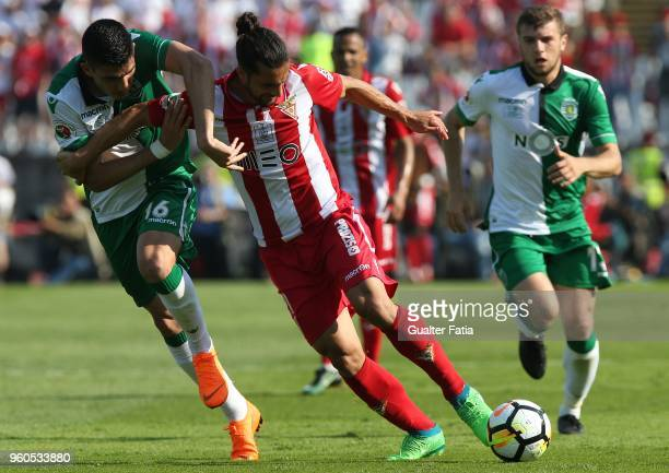 Aves defender Nelson Lenho from Portugal with Sporting CP midfielder Rodrigo Battaglia from Argentina in action during the Portuguese Cup Final match...