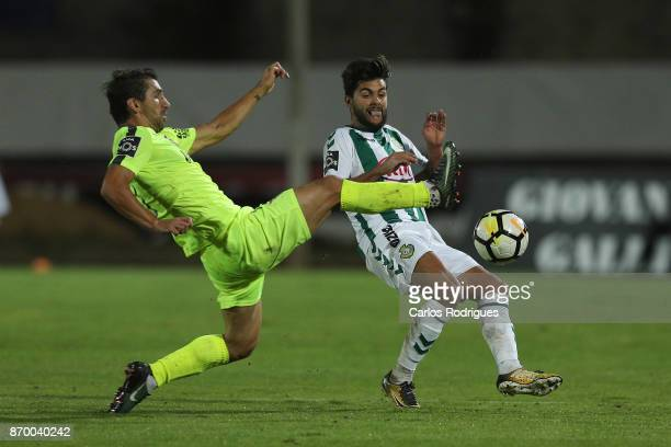 Aves defender Pedrinho from Portugal vies with Vitoria Setubal forward Joao Amaral from Portugal for the ball possession during the match between...
