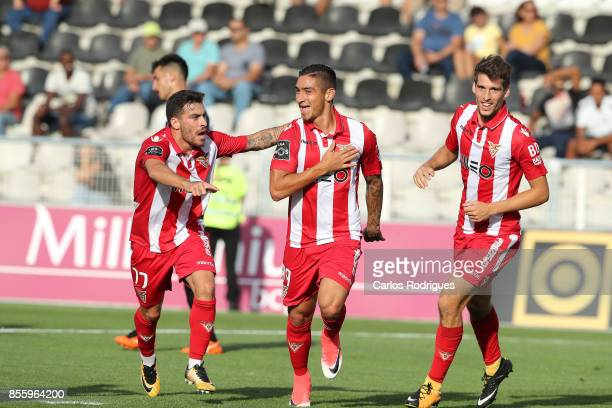Aves forward Cristian Arango from Colombia celebrates scoring Aves second goal with Aves forward Salvador Agra from Portugal and Aves forward...